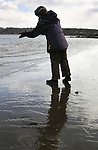 Detail photo as individual participants scattered samples of loose tobacco on the water during a Native American Water Blessing Ceremony held for the Hudson River, sponsored by the Association of Native American of the Hudson Valley, at Kingston Point Beach in Kingston, NY, on Saturday, March 4, 2017. Photo by Jim Peppler; Copyright Jim Peppler 2017