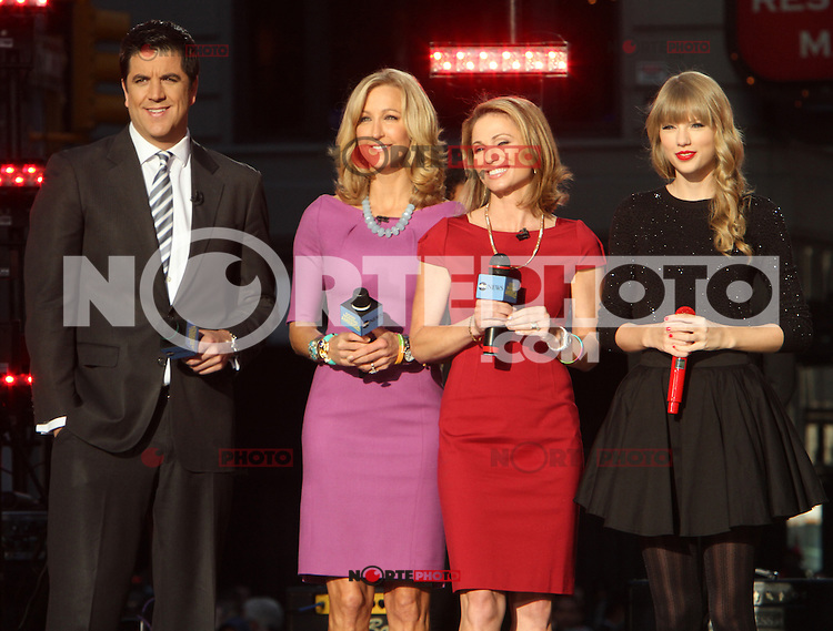 NEW YORK, NY - OCTOBER 23: Hosts, Josh Elliot, Lara Spencer, Amy Robach with Taylor Swift after her performance during the Good Morning America Concert Series in front of the Good Morning America Time Square studio in New York City. October 23, 2012. Credit: RW/MediaPunch Inc. /NortePhoto