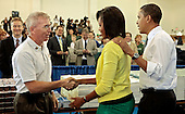 "Washington, DC - June 25, 2009 -- United States Representative Todd Platts (Republican of Pennsylvania) (L) greets U.S. first lady Michelle Obama and President Barack Obama (R) during a United We Serve event at Fort McNair June 25, 2009 in Washington, DC. Helping to fill 10,000 backpacks for children of military servicemen and women, the first family stuffed copies of ""The Lightning Thief,"" by Rick Riordan, and ""The Penderwicks,"" by Jeanne Birdsall into backpacks along with food items and a personal letter from the president and the first lady. .Credit: Chip Somodevilla - Pool via CNP"