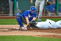 Angel Rosa (6) of the Salt Lake Bees dives for the plate and is tagged for the out by Brett Nicholas (22) of the Round Rock Express in Pacific Coast League action at Smith's Ballpark on August 13, 2016 in Salt Lake City, Utah. Round Rock defeated Salt Lake 7-3.  (Stephen Smith/Four Seam Images)