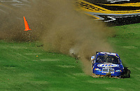 Nov. 1, 2009; Talladega, AL, USA; NASCAR Sprint Cup Series driver Kurt Busch slides through the infield grass during the Amp Energy 500 at the Talladega Superspeedway. Mandatory Credit: Mark J. Rebilas-