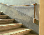 Tuscany, Italy<br /> Stairway detail with tasseled rope railing in the Palazzo Pubblico, San Quirico d'Orcia