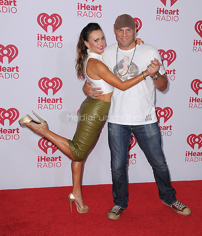 LAS VEGAS, NV - SEPTEMBER 19:  Karina Smirnoff and Randy Couture at the 2014 iHeartRadio Music Festival at the MGM Grand Garden Arena on September 19, 2014 in Las Vegas, Nevada. PGSK/MediaPunch