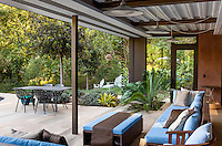 Open air living room connected to patio through sliding glass doors; Coyote House, LEED Platinum, SITES® residential home with sustainable garden; Santa Barbara California, Susan Van Atta design