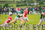 South Kerry's Denis Daly proves his worth seen here powering through challenge after challenge from the West Kerry players Daragh O'Sullivan & Kealan Dowling.  South Kerry 1-13 West Kerry 1-11.