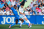 Marco Asensio of Real Madrid (R) fights for the ball with Dakonam Ortega Djene of Getafe CF (L) during the La Liga 2017-18 match between Getafe CF and Real Madrid at Coliseum Alfonso Perez on 14 October 2017 in Getafe, Spain. Photo by Diego Gonzalez / Power Sport Images