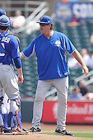 Pitching coach Frank Viola #16 of the Las Vegas 51s talks to his pitcher during a game against the Omaha Storm Chasers at Werner Park on August 17, 2014 in Omaha, Nebraska. The Storm Chasers  won 4-0.   (Dennis Hubbard/Four Seam Images)