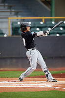 Lansing Lugnuts designated hitter Bo Bichette (10) follows through on a swing during a game against the Clinton LumberKings on May 9, 2017 at Ashford University Field in Clinton, Iowa.  Lansing defeated Clinton 11-6.  (Mike Janes/Four Seam Images)