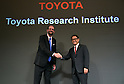 November 6, 2015, Tokyo, Japan - President Akio Toyoda, right, of Japans Toyota Motor Corp. shakes hands with Dr. Gill Pratt at the conclusion of a news conference at a Tokyo hotel on Friday, November 6, 2015. The worlds largest automaker announced the establishment of a new research and development arm headquartered in Californias Silicon Valley, to which Toyota will invest one billion dollars over the next five years to focus on artificial intelligence and robotics. Dr. Pratt, a former Defense Advanced Research Projects Agency program manager, heads the TRI. (Photo by Natsuki Sakai/AFLO) AYF -mis-