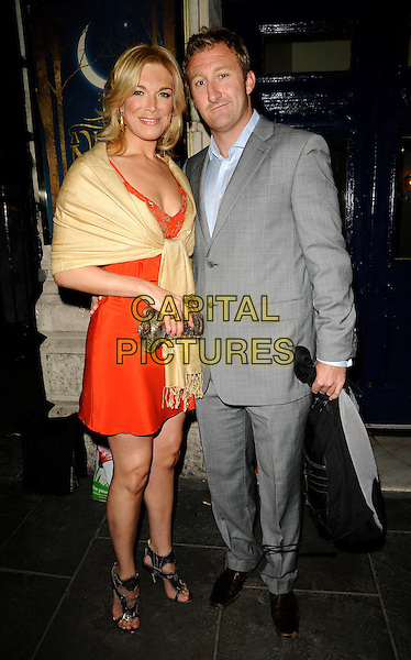 "HANNAH WADDINGHAM & GUEST .At the ""A Little Night Music"" Press Night, Garrick Theatre, London, England, UK,.7th April 2009..full length yellow wrap red dress grey gray suit pashmina clutch bag black shoes sandals .CAP/CAN.©Can Nguyen/Capital Pictures"