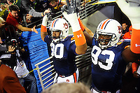 Jan 10, 2011; Glendale, AZ, USA; Auburn Tigers players Nick Fairley (90) and Mike Blanc (93) head out to the field before the 2011 BCS National Championship game against the Oregon Ducks at University of Phoenix Stadium.  Mandatory Credit: Mark J. Rebilas-