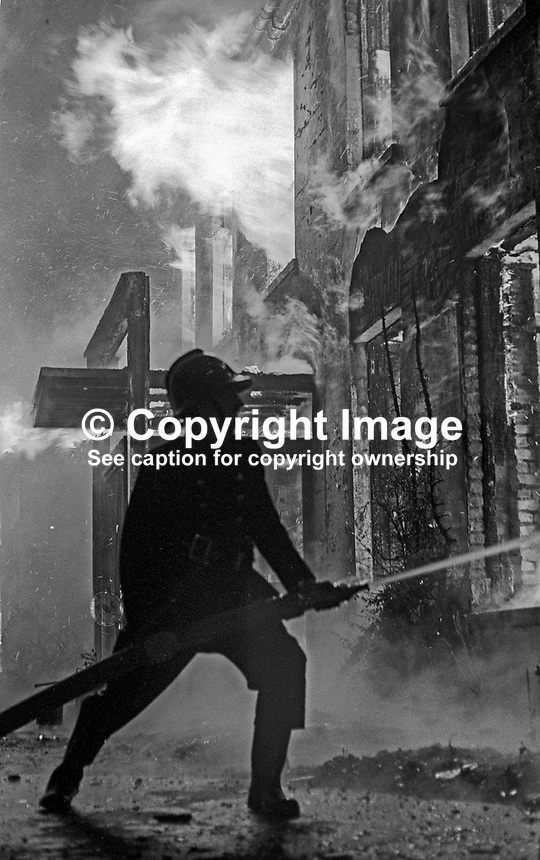 Fireman in action at the scene of the Provisional IRA bombing and subsequent fire at the Woodburn House Hotel on the Stewartstown Road, Belfast, N Ireland, UK, 1971. PLEASE CONTACT ME IF YOU CAN TELL ME EXACT DATE OF INCIDENT. 197100000445b<br />