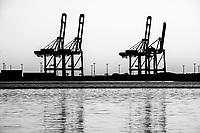cranes at the harbor in aarhus jutland, denmark.