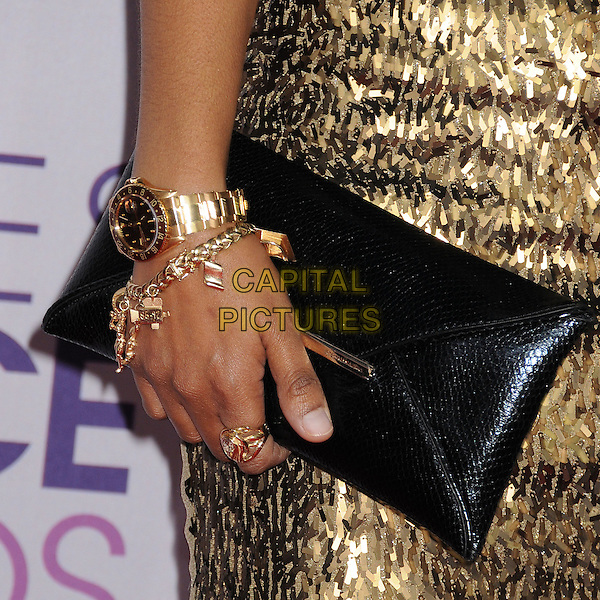 Tempestt Bledsoe's bag .People's Choice Awards 2013 - Arrivals held at Nokia Theatre L.A. Live, Los Angeles, California, USA..January 9th, 2013.detail black gold bracelet watch ring jewellery jewelry clutch bag sequins sequined .CAP/ADM/BP.©Byron Purvis/AdMedia/Capital Pictures.