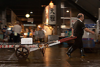 A worker pulls a cart at Tsukiji wholesale fish market in Tokyo, Japan. July 15th 2008