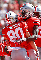 Ohio State Buckeyes wide receiver Binjimen Victor, center, congratulates Ohio State Buckeyes wide receiver C.J. Saunders (80) after Saunders scored during the second quarter of a NCAA college football game between the Ohio State Buckeyes and the UNLV Rebels on Saturday, September 23, 2017 at Ohio Stadium in Columbus, Ohio. [Joshua A. Bickel/Dispatch]