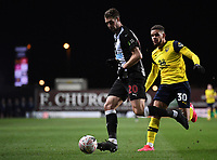 4th February 2020; Kassam Stadium, Oxford, Oxfordshire, England; English FA Cup Football; Oxford United versus Newcastle United; Florian Lejeune of Newcastle clears the ball under pressure from Marcus Browne of Oxford