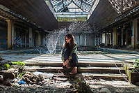 Meredith Rose Baylis beside the swimming pool of the once luxurious Dormy Hotel, now derelict after a suspicious fire.  Most of the complex was devastated and for years has been left derelict awaiting the insurance payout.