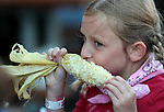Emma Albugut, 8, enjoys corn-on-the-cob before the Reno Rodeo in Reno, Nev., on Friday, June 22, 2012..Photo by Cathleen Allison