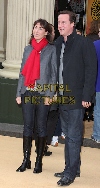 SAMANTHA & DAVID CAMERON.10th Anniversary Performance of 'The Lion King' at the Lyceum Theatre, London, England..October 18th 2009.full length black jacket jeans denim grey gray top red scarf holding hands brown boots politician sam married husband wife .CAP/ROS.©Steve Ross/Capital Pictures.