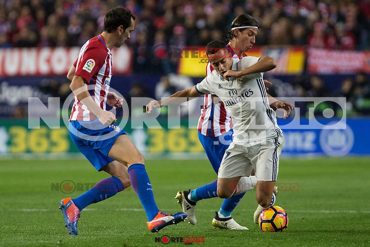 Atletico de Madrid's Diego Godin Real Madrid's Lucas Vazquez during the match of La Liga between Atletico de Madrid and Real Madrid at Vicente Calderon Stadium  in Madrid , Spain. November 19, 2016. (ALTERPHOTOS/Rodrigo Jimenez) /NORTEPHOTO.COM