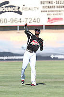 Lewis Brinson (25) of the High Desert Mavericks throws before a game against the San Jose Giants at Mavericks Stadium on June 14, 2015 in Adelanto, California. High Desert defeated San Jose, 7-5. (Larry Goren/Four Seam Images)