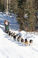 Musher Sonny Lindner on Long Lake at the Re-Start of the 2011 Iditarod Sled Dog Race in Willow, Alaska.
