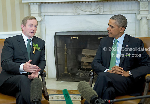 United States President Barack Obama, right, meets Prime Minister Enda Kenny of Ireland in the Oval Office of the White House in Washington, D.C. on Friday, March 14, 2014.<br /> Credit: Ron Sachs / Pool via CNP