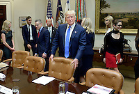 United States President Donald Trump looks on before a listening session on domestic and international human trafficking in the Roosevelt Room of the White House on February 23, 2017 in Washington, DC. Photo Credit: Credit: Olivier Douliery/CNP/AdMedia