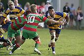 J. Maka takes on the Waiuku's S Kennedy. Counties Manukau Premier Club Rugby, Waiuku vs Patumahoe played at Rugby Park, Waiuku on the 8th of April 2006. Waiuku won 18 - 15