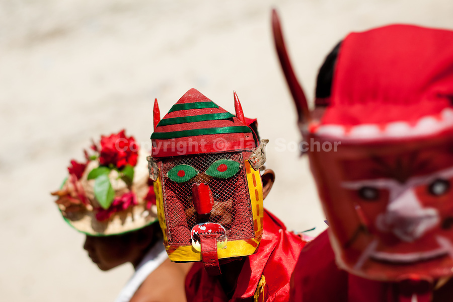 """The Devil dancers (Diablo) take part in the religious procession in Atanquez, Sierra Nevada, Colombia, 3 June 2010. A colorful celebration of Corpus Christi is held in the Kankuamo Indians territory every year. """"The Dance of the Devils"""" is an ancient tradition kept for centuries on the Colombia's Caribbean coast. This Christian religious event usually coincides with the summer solstice, which has always been the key point for the native cultures and for the black African slaves. Due to this confluence, the Kankuamo myths, the African animistic rites and other Pre-Columbian features have blended with the Spanish Catholic festival into a lively spectacle."""
