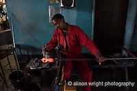 Africa, Swaziland, Malkerns. Nest organization artisan partnership. Ngwenya Glass, a recycled glass workshop. Gary Hayter's shop