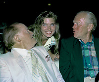 Winston-Salem, North Carolina, USA, May 31, 1991<br /> Bob Hope and Former President Gerald R. Ford sit in a golf cart while greeting fans and guests at the annual Bill Crosby Clambake Golf Tournament at the Bermuda Run Country Club. Jena Wright poses with Hope and Ford Credit: Mark Reinstein/MediaPunch