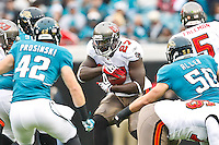 December 11, 2011:  Tampa Bay Buccaneers running back LeGarrette Blount (27) runs into the Jaguars defensive line during first half action between the Jacksonville Jaguars and the Tampa Bay Buccaneers played at EverBank Field in Jacksonville, Florida.  ........