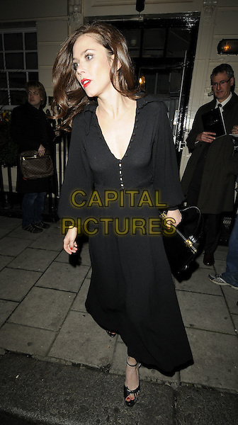 "ANNA FRIEL.The ""Breakfast At Tiffany's"" evening performance, Theatre Royal Haymarket, London, England..November 16th, 2009.full length black dress bag purse profile mouth open .CAP/CAN.©Can Nguyen/Capital Pictures."