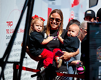 Oct 18, 2019; Ennis, TX, USA; NHRA female fan with two young children in the pits during qualifying for the Fall Nationals at the Texas Motorplex. Mandatory Credit: Mark J. Rebilas-USA TODAY Sports