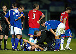 Stevie Tosh in agony on the pitch as he gets medical attention