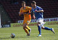 Jack Compton (right) being closed down by Ross Forbes in the Motherwell v St Johnstone Clydesdale Bank Scottish Premier League match played at Fir Park, Motherwell on 28.4.12.