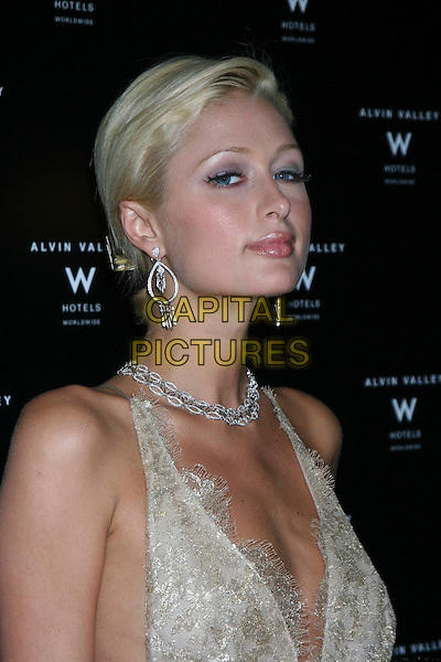 PARIS HILTON.Olympus Fashion Week Spring 2006.Albin Valley, New York, 12th September 2005.portrait headshot white lace layer chiffon dress silver earrings necklace .Ref: IW.www.capitalpictures.com.sales@capitalpictures.com.©Capital Pictures