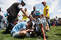 San Francisco, CA - Sunday, July 13, 2014: An Argentina fan cries after they lost the World Cup final. Thousands of fans gathered for a public viewing at the Civic Center to watch Germany vs Argentina in the finals of the World Cup.