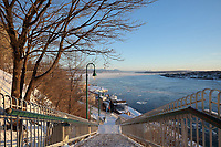 Steps on the Promenade des Gouverneurs leading down to the Saint Lawrence river in winter, in Quebec City, Quebec, Canada. The Governor's Promenade is a boardwalk linking the Plains of Abraham Park to the Dufferin Terrace. The Historic District of Old Quebec is listed as a UNESCO World Heritage Site. Picture by Manuel Cohen