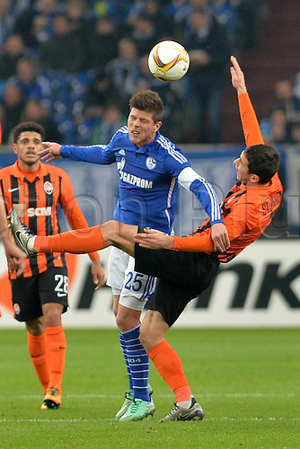 25.02.2016. Gelsenkirchen, Germany. Europa League Round of 32 Second Leg soccer match between Schalke 04 and FC Shakhtar Donetsk in the Veltins Arena in Gelsenkirchen, Germany. Klaas Jan Huntelaar ( Schalke ), and Taras Stepanenko ( Donezk )