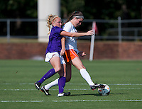 Annie Steinlage (10) of Virginia fights for the ball with Tabitha Padgett (7) of Clemson at Klockner Stadium in Charlottesville, VA.  Virginia defeated Clemson, 3-0.