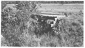 RGS one-panel pile trestle Bridge 127-A (MP 126.4 or so).  Menefee is at MP 125.31 and Brayton is at MP 129.36.<br /> RGS  Menefee, CO  Taken by Maxwell, John W. - 8/16/1962