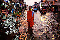 A Buddhist monk walks in a flooded street in central Bangkok October 24, 2011. Thailand is struggling with its worst flooding in 50 years, which has affected a third of its provinces and could swamp more of its densely populated capital, Bangkok, if water flowing from the north and heavy rain cause canals to burst their banks.  REUTERS/Damir Sagolj (THAILAND)