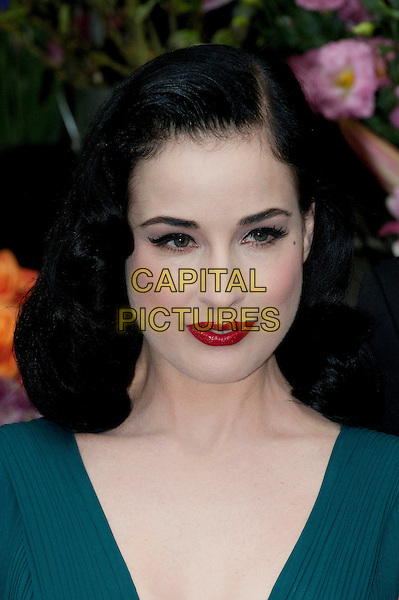 Dita Von Teese .Dita Von Teese, the burlesque superstar, appeared at Liberty London to launch her debut fragrance, named after herself, London, England..May 1st, 2012.headshot portrait red lipstick teal blue green perfume.CAP/BF.©Bob Fidgeon/Capital Pictures.