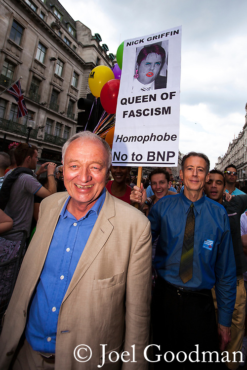 "© Joel Goodman - 07973 332324 . 02/07/2011 . London , UK . London mayor KEN LIVINGSTONE and human rights campaigner PETER TATCHELL with a placard depicting BNP leader Nick Griffin as the "" Queen of Fascism "" . Tens of thousands take part in the annual Pride march in London . Photo credit : Joel Goodman"