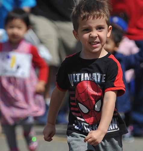 Children compete in the the Kids Mini Marathon in Eisenhower Park's Safety Town during Long Island Marathon Weekend festivities on Saturday, May 5, 2018.