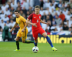 John Stones of England glides past Jamie Maclaren of Australiaduring the International Friendly match at the Stadium of Light, Sunderland. Photo credit should read: Simon Bellis/Sportimage