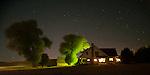 Farmhouse at night with stars shining bright